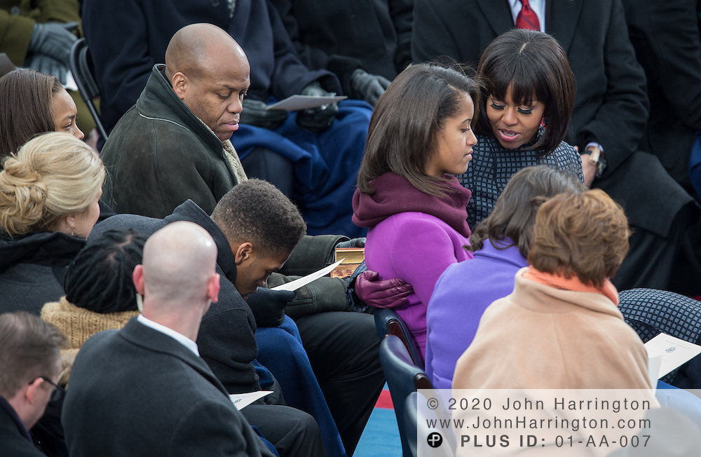 Michelle Obama, her brother Craig Robinson, and Sasha Obama during the 57th Presidential Inauguration of President Barack Obama at the U.S. Capitol Building in Washington, DC January 21, 2013.