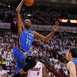 Jun 17, 2012; Miam, FL, USA; Oklahoma City Thunder small forward Kevin Durant (35) drives to the basket against the Miami Heat during the first quarter in game three in the 2012 NBA Finals at the American Airlines Arena. Mandatory Credit: Derick E. Hingle-US PRESSWIRE