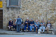 Town square, old folks,San Quirico d'Orcia,Tuscany, Italy, Europe