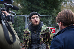 Harefield, UK. 16 January, 2020. Sky News' Jason Farell interviews Stop HS2 activist Quercus after he left the Harvil Road wildlife protection camp in the Colne Valley voluntarily after a day and a night spent high up in a tree in woodland. 108 ancient woodlands are set to be destroyed by the high-speed rail link and further destruction of trees for HS2 in the Harvil Road area is believed to be imminent.