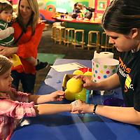 Libby Ezell | BUY AT PHOTOS.DJOURNAL.COM<br /> Ava Lincks, 6 gets a Healthworks tattoo from volunteer Skye Kinard Saturday at Healthworks 7th Birthday