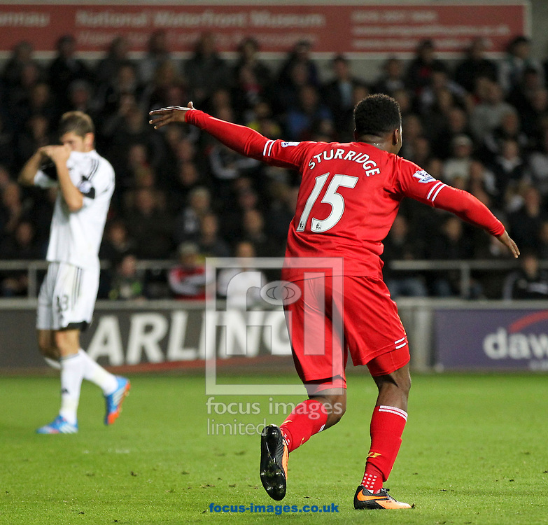 Picture by Mike  Griffiths/Focus Images Ltd +44 7766 223933<br /> 16/09/2013<br /> Daniel Sturridge of Liverpool celebrates his teams second goal during the Barclays Premier League match at the Liberty Stadium, Swansea.