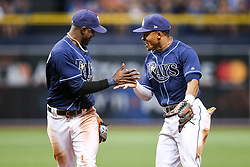 July 8, 2017 - St. Petersburg, Florida, U.S. - WILL VRAGOVIC   |   Times.Tampa Bay Rays shortstop Adeiny Hechavarria (11) gets a high five from center fielder Mallex Smith (0) after his play on the liner by Boston Red Sox catcher Sandy Leon (3) to end the top of the fifth inning of the game between the Boston Red Sox and the Tampa Bay Rays at Tropicana Field in St. Petersburg, Fla. on Saturday, July 8, 2017. (Credit Image: © Will Vragovic/Tampa Bay Times via ZUMA Wire)