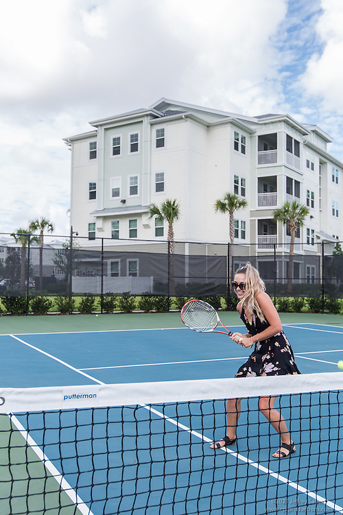 Lifestyle photo of the tennis court at Epic at Gateway Centre in St. Petersburg Florida by Jeffrey Sauers of Commercial Photographics, Architectural Photo Artistry in Washington DC, Virginia to Florida and PA to New England