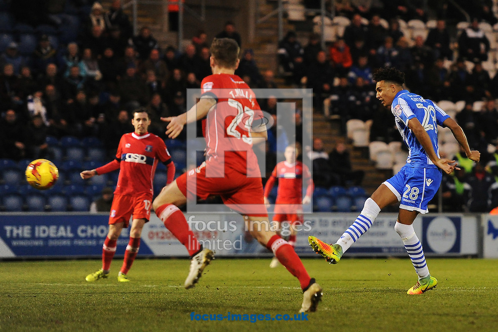 Kurtis Guthrie of Colchester United scores his sides third goal to make the scoreline 3-1  during the Sky Bet League 2 match between Colchester United and Carlisle United at the Weston Homes Community Stadium, Colchester<br /> Picture by Richard Blaxall/Focus Images Ltd +44 7853 364624<br /> 07/01/2017