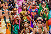 10 AUGUST 2012 - PHOENIX, AZ:  Boys dressed as Krishna and girls dressed as Rhada wait for a pageant to start during the celebration of Janmashtami at Ekta Mandir, a Hindu temple in central Phoenix. Janmashtami is the Hindu holy day that celebrates the birth of Lord Krishna. In the Hindu religion, Rhada is the friend of lover of Krishna. Hindu communities around the world celebrate the holy day. In Arizona, most of the Hindu temples in the Phoenix area have special celebrations of the day..PHOTO BY JACK KURTZ