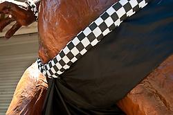 Ogoh-Ogoh wearing a poleng sash.