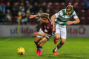 Celtic FC Midfielder Stuart Armstrong and Hearts FC Midfielder Sam Nicholson tumbling after challenge during the Scottish League Cup presented by Ulilita Energy quarter final match between Heart of Midlothian and Celtic at Tynecastle Stadium, Gorgie, Scotland on 28 October 2015. Photo by Craig McAllister.