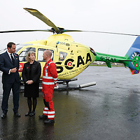 FREE TO USE PHOTOGRAPH....30.10.15<br /> Scotland's Charity Air Ambulance (SCAA) unveiled it's new helicopter at Perth airport this morning a EC135 T2i (pictured) which replaces the Bolkow 105 helicopter which is retiring from service. The new helicopter will increase speed, range, endurance and payload, allow SCAA to fly at night and in cloud. Scottish Health Minister Shona Robison MSP helped unveil the new helicopter, she is pictured with from left, Paramedic Chris Darlington, John Bullough Chairman SCAA and Paramedic John Salmond.<br /> for further info please contact Maureen Young on 07778 779000<br /> Picture by Graeme Hart.<br /> Copyright Perthshire Picture Agency<br /> Tel: 01738 623350  Mobile: 07990 594431