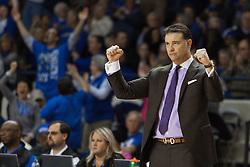 Kentucky head coach Matthew Mitchell celebrates a three point basket in the second half.<br /> <br /> The University of Kentucky hosted the University of Tennessee, Monday, Jan. 25, 2016 at Memorial Coliseum in Lexington .