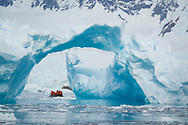 Zodiac cruising among the icebergs in Lindblad Cove, Antarctica