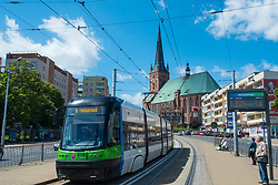Public tram and Cathedral Basilica of St. James the Apostle in Szczecin , Poland