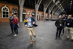 © Licensed to London News Pictures . 26/05/2019. Manchester, UK. A Liberal Democrat activist runs through the counting hall . The count for seats in the constituency of North West England in the European Parliamentary election , at Manchester Central convention centre . Photo credit: Joel Goodman/LNP
