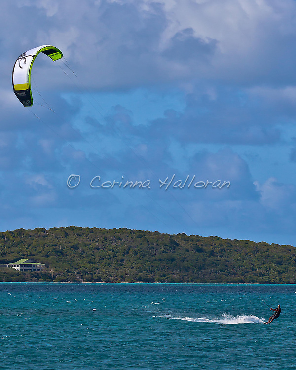Swan 80, Selene, races along the southern coast of St. Maarten during the RORC Caribbean 600 Kite surfing around the world.
