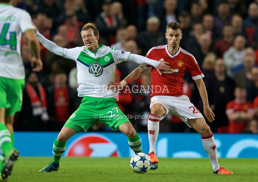 MANCHESTER, ENGLAND - Wednesday, September 30, 2015: Manchester United's Morgan Schneiderlin is eventually shown a yellow card for this tackle on VfL Wolfsburg's Maximilian Arnold during the UEFA Champions League Group B match at Old Trafford. (Pic by David Rawcliffe/Propaganda)