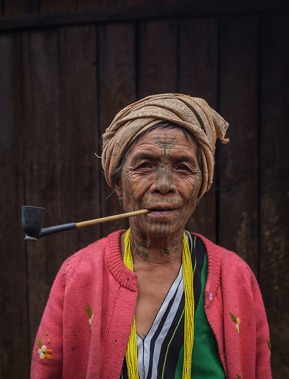 In the remote mountains of Chin State in western Myanmar are groups of tribal people for whom facial tattoos are a sign of beauty for many of the older women. Mount Victoria, the highest peak in Chin State, is home to the Munn and Dai tribes, both with their own recognisable facial inkings. The Muun women have a series of small, interlinked rings, arranged in a half-moon, tattooed from the cheeks down to the neck. The practice has been banned by the government for many years that now it's rare to meet younger women with the tattoos.
