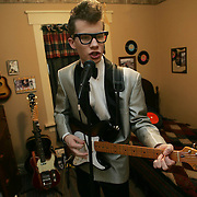 Richie Lee,  a high school student from Des Moines, Iowa, rehearses a Buddy Holly song in his bedroom recently.  Lee, who has performed as Holly on stage since the age of 7, also has teamed with a couple of band members in their 50's.  They play all around the state on weekends.  Holly was killed in a plane crash near Mason City, Iowa, on Feb. 3, 1959, after playing his last gig at the Surf Ballroom in Clear Lake, Iowa.
