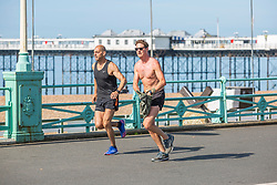 © Licensed to London News Pictures. 03/06/2018. Brighton, UK. Members of the public take advantage of the warmer weather to go for an early morning run on the the Brighton and Hove promenade on Sunday morning. Photo credit: Hugo Michiels/LNP