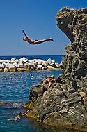 Cliff diver in Manarola  Cinque Terre Italy
