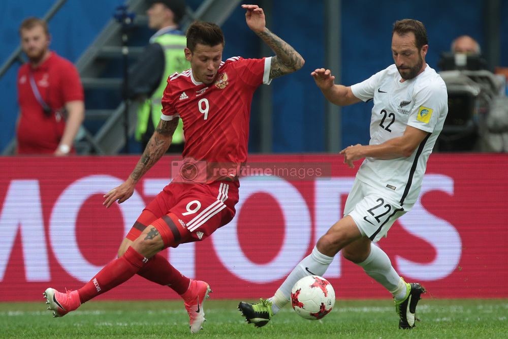June 17, 2017 - Saint Petersburg, Russia - Fedor Smolov (L) of the Russian national football team and Andrew Durante of the New Zealand national football team vie for the ball during the 2017 FIFA Confederations Cup match, first stage - Group A between Russia and New Zealand at Saint Petersburg Stadium on June 17, 2017 in St. Petersburg, Russia. (Credit Image: © Igor Russak/NurPhoto via ZUMA Press)