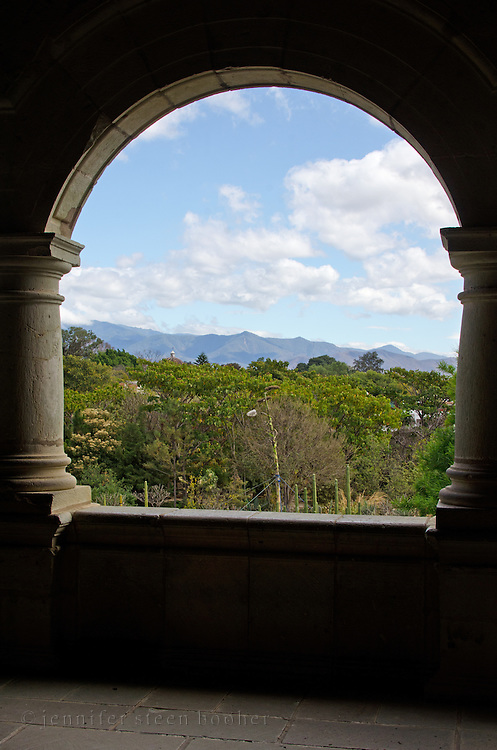 Looking out from an open porch in the Centro Cultural Santo Domingo over the Jardín Etnobotánico to the distant mountains.