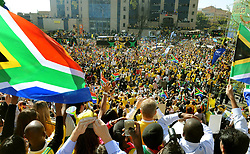 Thousands of fans watch the South African team (nicknamed Bafana Bafana) travel on a bus through the centre of Sandton in Johannesburg ahead of the World Cup tournament which begins in South Africa on Friday.