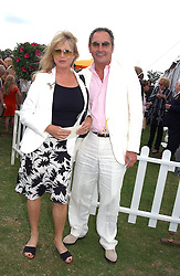 PATTI BOYD & ROD  WESTON at the Veuve Clicquot sponsored Gold Cup or the British Open Polo Championship won by The  Azzura polo team who beat The Dubai polo team 17-9 at Cowdray Park, West Sussex on 18th July 2004.