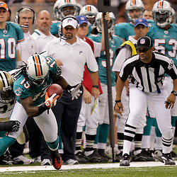 2009 September 03: New Orleans Saints cornerback Malcolm Jenkins (27) hits Miami Dolphins wide receiver Davone Bess (15) after making a catch during a preseason game between the Miami Dolphins and the New Orleans Saints at the Louisiana Superdome in New Orleans, Louisiana.