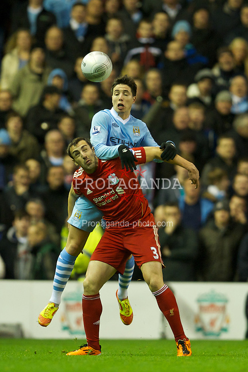 LIVERPOOL, ENGLAND - Wednesday, January 25, 2012: Liverpool's Jose Enrique in action against Manchester City's Samir Nasri during the Football League Cup Semi-Final 2nd Leg at Anfield. (Pic by David Rawcliffe/Propaganda)