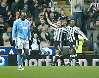 Photo. Andrew Unwin.<br /> Newcastle United v Manchester City, Barclaycard Premier League, St James' Park, Newcastle upon Tyne 22/11/2003.<br /> Newcastle's Alan Shearer (c) celebrates his second goal with teammate Titus Bramble (r), while City's Nicolas Anelka (l)  looks dejected.