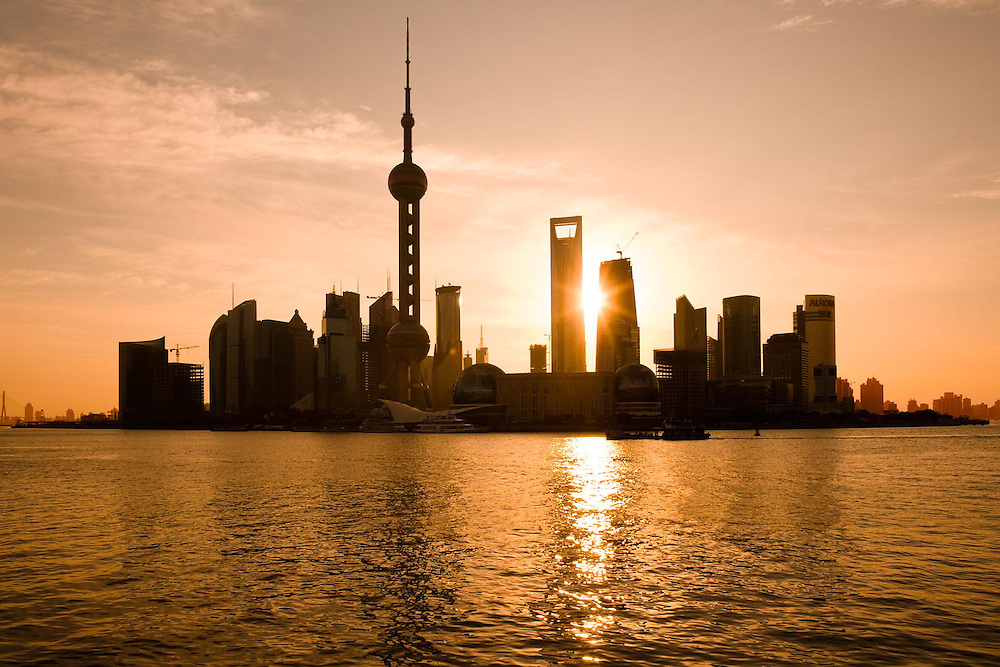 Skyline of Pudong and Lujiazui at sunrise with the Oriental Pearl Tower and the new Shanghai World Finance Centre (SWFC) across the Huangpu river, Shanghai, China, Asia