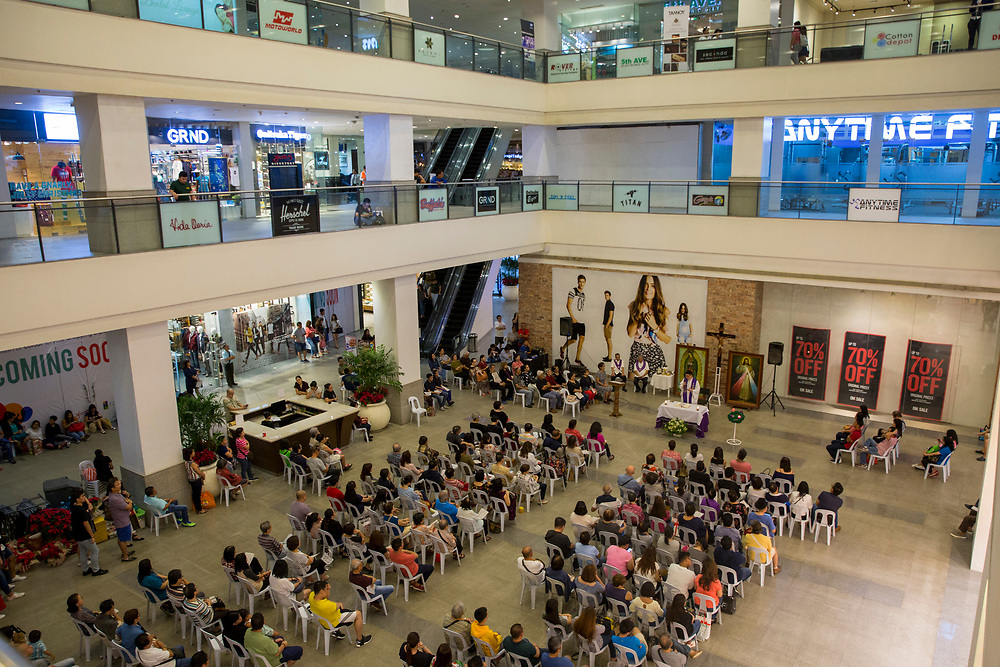 People attending a catholic mass service inside Glorietta Shopping Mall, Makati, Metro Manila, Philippines. The Philippines is one of only two predominantly catholic countries in Asia, the other being East Timor.  (photo by Andrew Aitchison / In pictures via Getty Images)
