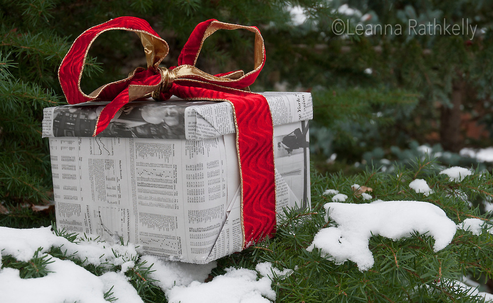 A Christmas present is wrapped in the New York Times and ready for Christmas.