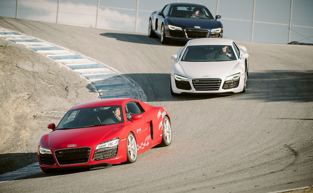 Red, white, and blue R8s in the Corkscrew at Laguna Seca | Audi sportscar experience