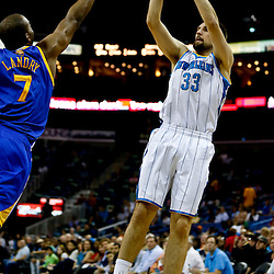 Mar 18, 2013; New Orleans, LA, USA; New Orleans Hornets power forward Ryan Anderson (33) shoots over Golden State Warriors power forward Carl Landry (7) during the first quarter a game at the New Orleans Arena Mandatory Credit: Derick E. Hingle-USA TODAY Sports