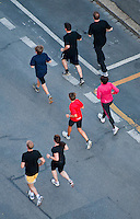 Berner Oberland, Switzerland. Joggers in the Interlaken street race, seen from above.