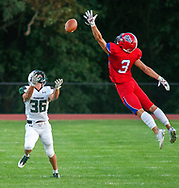 Neshaminy's Ian Sheehan #3 reaches for the ball as Pennridge's Brayden Landherr #36 awaits the pass in the first quarter of the Pennridge at Neshaminy football game Friday, August 30, 2019 at Harry Frank Stadium in Langhorne, Pennsylvania. (WILLIAM THOMAS CAIN/PHOTOJOURNALIST)