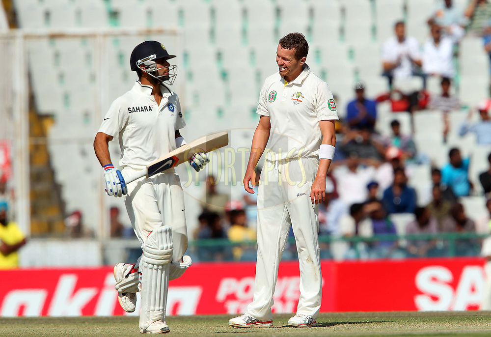 Peter Siddle of Australia  reacts after being knocked for four during day 5 of the 3rd Airtel Test Match between India and Australia held at the PCA Stadium, Mohali, India on the 18th March 2013..Photo by Ron Gaunt/BCCI/SPORTZPICS ..Use of this image is subject to the terms and conditions as outlined by the BCCI. These terms can be found by following this link:..http://www.sportzpics.co.za/image/I0000SoRagM2cIEc