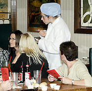 """Inspector Dodges (aka Jenna Rebbin Shaw) during Mayhem & Mystery's production of """"I'll Be Home Shopping for Christmas"""" at the Spaghetti Warehouse in downtown Dayton, Monday, November 9, 2009."""