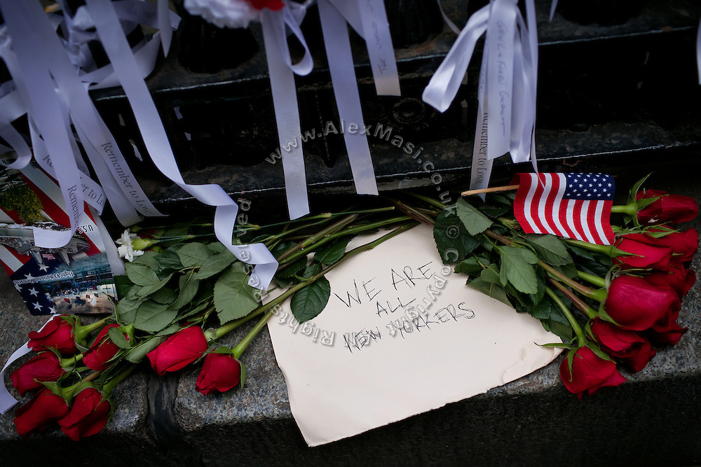 """Roses and the sign: """"We are all New Yorkers"""", are photographed on the street in Lower Manhattan, New York, USA, on the 10th anniversary of the 9/11 attacks on the Word Trade Centre."""