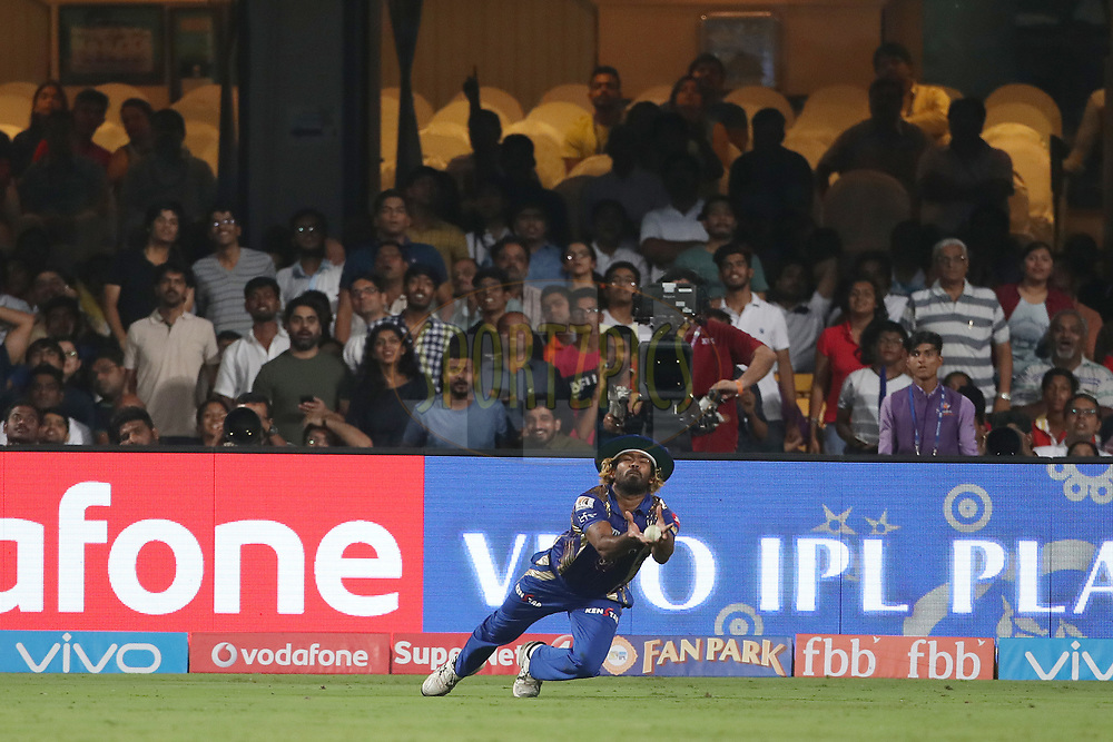 Lasith Malinga of the Mumbai Indians takes the catch to dismiss Suryakumar Yadav of the Kolkata Knight Riders during the 2nd qualifier match of the Vivo 2017 Indian Premier League between the Mumbai Indians and the Kolkata Knight Riders held at the M.Chinnaswamy Stadium in Bangalore, India on the 19th May 2017<br /> <br /> Photo by Ron Gaunt - Sportzpics - IPL