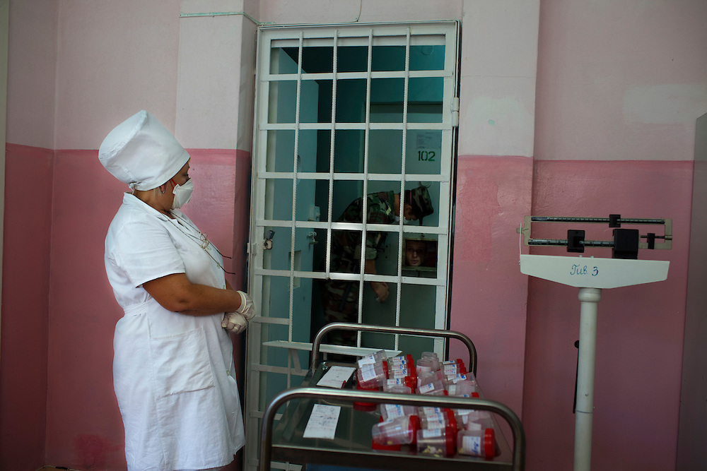 A nurse waits to distribute medicine to TB patients at a prison hospital in Chisinau.