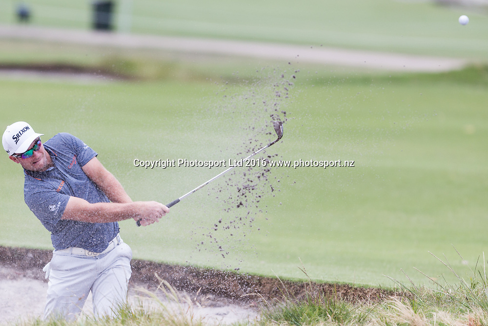 Ryan Fox (NZL)  plays out of the bunker during the round 1 of the World Cup of Golf at Kingston Heath Golf Club, Melbourne Australia. Thursday 24th November 2016. Copyright Photo Brendon Ratnayake / www.photosport.nz