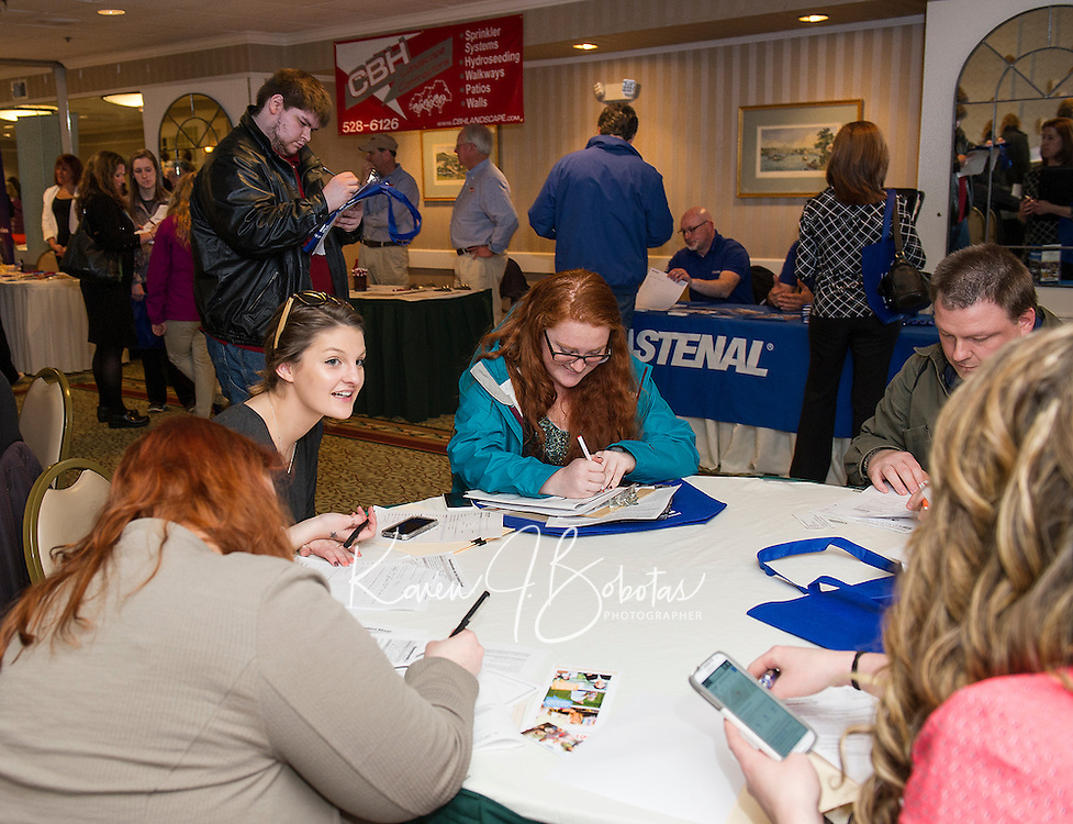Applications being filled out by job seekers at the Lakes Region Job Fair held at the Margate Resort on Wednesday afternoon.  (Karen Bobotas/for the Laconia Daily Sun)
