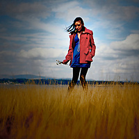Young woman amongst grass