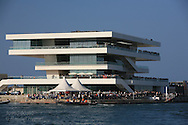 Veles e Vents building, or Sails and Winds, dominates Port America's Cup with its modernistic architecture perched at the harbor entrance; Valencia, Spain.