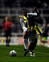Photo: Jed Wee.<br /> Newcastle United v Fenerbahce. UEFA Cup. 19/10/2006.<br /> <br /> Newcastle's Charles N'Zogbia (L) tries to stop Fenerbahce's Onder Turaci.