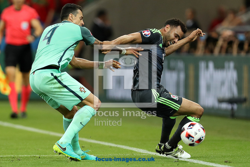 Hal Robson Kanu of Wales and Jose Fonte of Portugal in action during the UEFA Euro 2016 semi-final match at Stade de Lyons, Lyons<br /> Picture by Paul Chesterton/Focus Images Ltd +44 7904 640267<br /> 06/07/2016