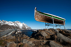Old wooden fishing boat perched high above village of Henningsvaer in Lofoten Islands in Norway