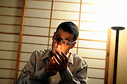 "Jake Adelstein, a former reporter at Japan's largest daily newspaper, Yomiuri Shimbun, lights a cigarette during an interview at an undisclosed location in Japan on Aug. 29, 2008. In 2005, American Adelstein -- who is the author of the recently released ""Tokyo Vice"" -- uncovered a scandal involving senior members of Japan's mafia, the yakuza, visiting a medical center in Los Angeles to undergo liver transplants, despite being bared from entry due to having criminal records or suspected affiliation with Japanese organized crime groups. Within days, however, Adelstein was visited by mob members and told to either ""erase the story or be erased."" He erased the story and resigned from the Yomiuri, though a  leak of his story at one time pushed Adelstein and his family into hiding..Photographer: Robert Gilhooly"